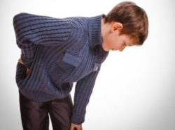 у юноши болит спина